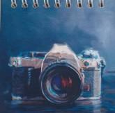 دفتر یادداشت بی خط 9*9 (طرح دوربین،کد 7)،(سیمی)